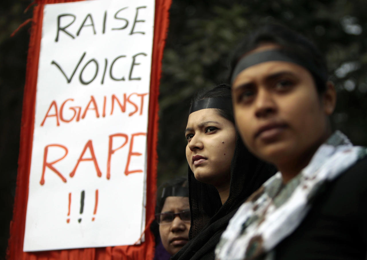 Bangladeshi girls hold placards as they stand to form a human chain to protest against the recent gang rape of a young woman on a moving bus in New Delhi, in Dhaka, Bangladesh, Wednesday, Jan. 9, 2013. An Indian magistrate ruled Monday that the media will not be allowed to attend pre-trial hearings or the trial of the five men accused of raping and killing a young student in the Indian capital, a police official said. (AP Photo/A.M. Ahad)