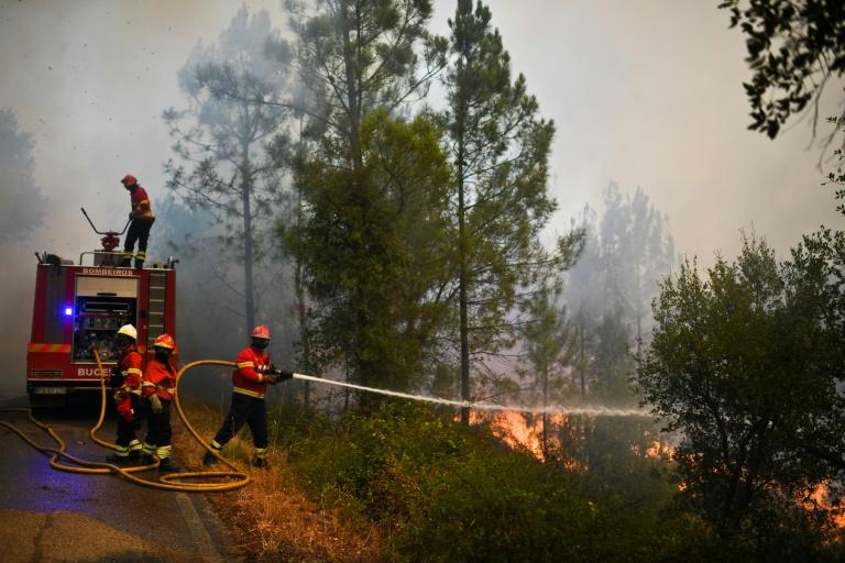 Firefighters battling blazes in central Portugal are worried about the hotter weather forecast, which increases the risk that old fire sites will rekindle or new fires will break out in the coming days