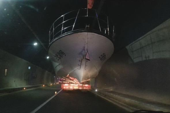Video: https://vimeo.com/109216243 Mandatory Credit: Photo by XJZ/Quirky China News/REX (4209942f) The yacht is slowly towed out of the tunnel Large yacht gets stuck in highway tunnel, Tongren, Guizhou Province, China - 13 Oct 2014 A large yacht is seen stuck in a highway tunnel in Tongren, southwest China's Guizhou Province. The truck was being towed to Sinan County, but the delivery driver ignored warnings about the tunnels width and height restrictions. As such, when he drove into the tunnel the yacht quickly became stuck because it was too tall. Police were called and they had to deflate the tow trucks tyres and close the tunnel as it slowly inched back out again.