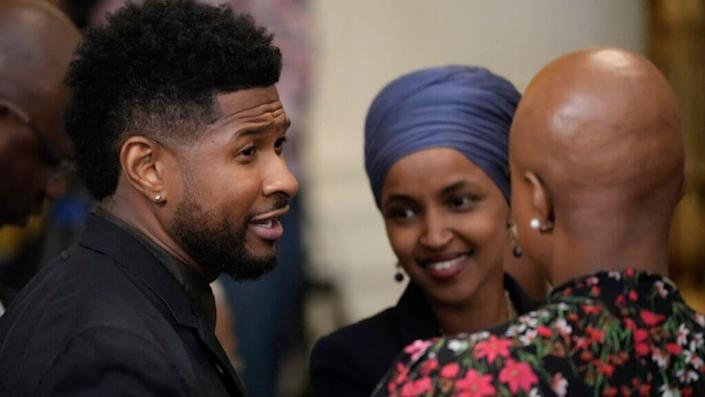Usher speaks with Rep. Ilhan Omar (D-MN) and Rep. Ayanna Pressley, theGrio.com
