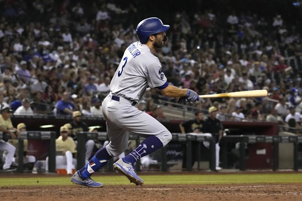 The Dodgers' Chris Taylor watches his two-run triple against the Arizona Diamondbacks in the seventh inning.