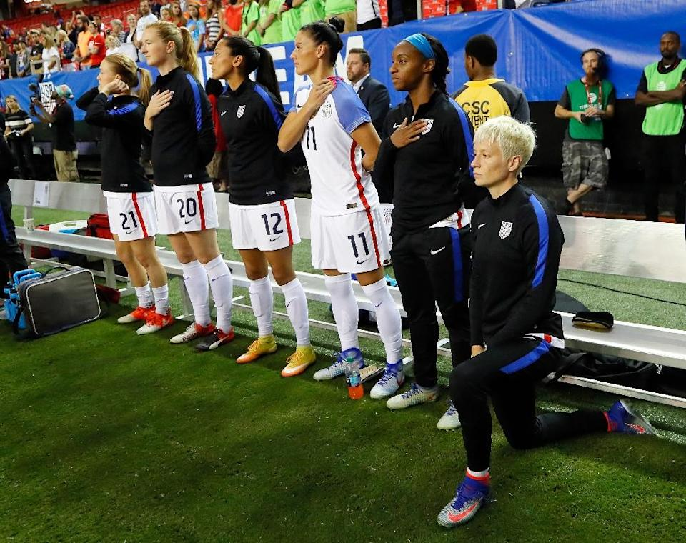Megan Rapinoe (R) kneels during the National Anthem prior to a match in 2016 (AFP Photo/Kevin C. Cox)
