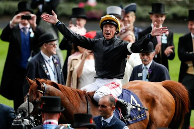 Pulling the strings -- Stradivarius and Frankie Dettori won a historic third successive Goodwood Cup and within one win of a repeat of a million pound bonus they and trainer John Gosden won last year (AFP Photo/Adrian DENNIS)