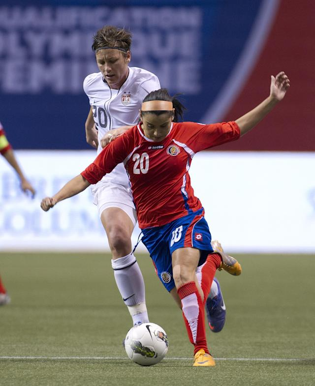 VANCOUVER, CANADA - JANUARY 27: Wendy Acosta #20 of Costa Rica is challenged by Abby Wambach #20 of the United States during the second half of semifinals action of the 2012 CONCACAF Women's Olympic Qualifying Tournament at BC Place on January 27, 2012 in Vancouver, British Columbia, Canada. (Photo by Rich Lam/Getty Images)