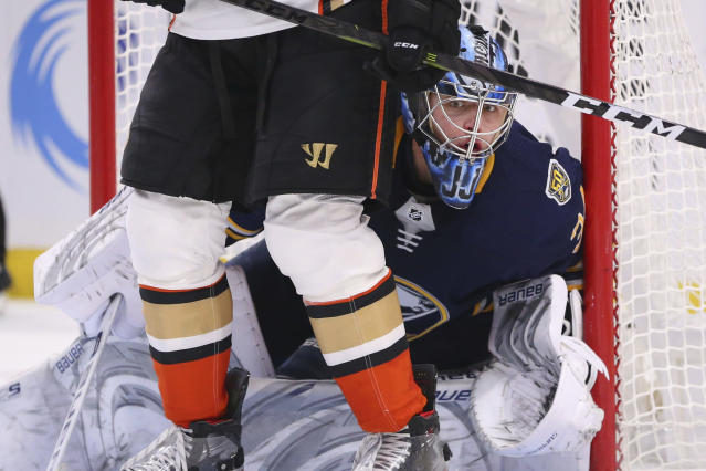 Buffalo Sabres goalie Jonas Johansson (34) is screened by a Anaheim Ducks player during the second period of an NHL hockey game Sunday, Feb. 9, 2020, in Buffalo, N.Y. (AP Photo/Jeffrey T. Barnes)