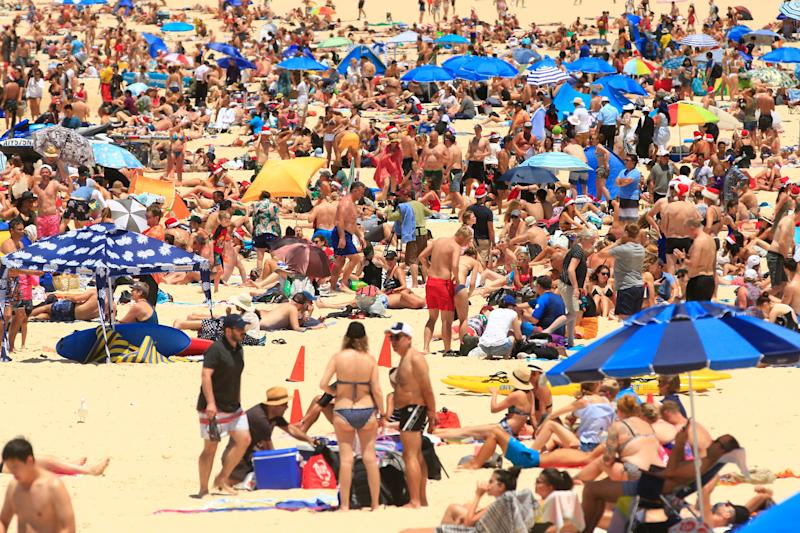 Crowds celebrate Christmas on Bondi Beach in 2018 in Sydney, Australia. December is one of the hottest months of the year across Australia, with Christmas Day traditionally involving a trip to the beach and celebrations outdoors. <i>(Photo by Mark Evans/Getty Images)</i>