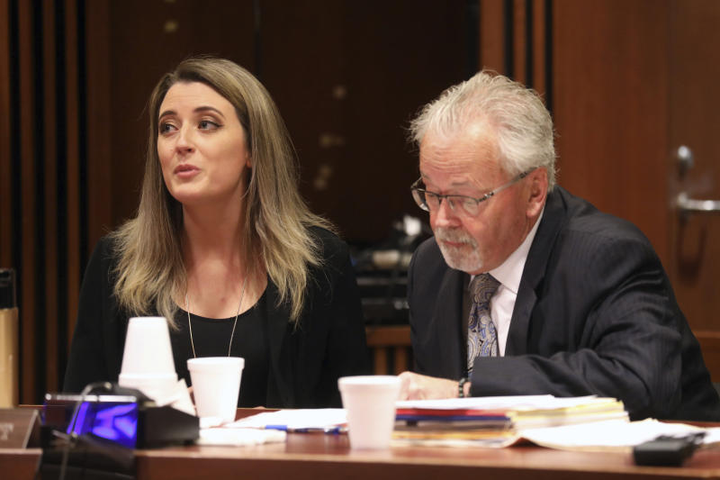 Kate McClure, 29, charged with theft by deception in the $400K GoFundMe scam, with her lawyer Jim Gerrow Jr., pleads guilty before State Superior Court Judge Christopher Garrenger in Burlington County Courthouse, Mt. Holly, N.J. Monday April 15, 2019. (David Swanson/The Philadelphia Inquirer via AP)