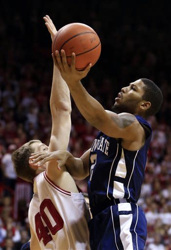 Penn State's D.J. Newbill (2) shoots against Indiana's Cody Zeller during the first half of an NCAA college basketball game, Wednesday, Jan. 23, 2013, in Bloomington, Ind. (AP Photo/Darron Cummings)