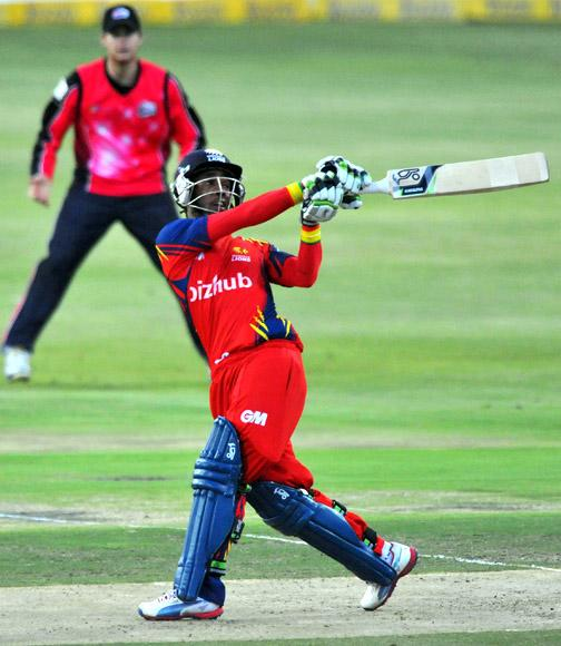 Thami Taolekile of the Lions hits to the boundary during the Karbonn Smart CLT20 Final match between bizhub Highveld Lions and Sydney Sixers at Bidvest Wanderers Stadium on October 28, 2012 in Johannesburg, South Africa. (Photo by Duif du Toit/Gallo Images/Getty Images)
