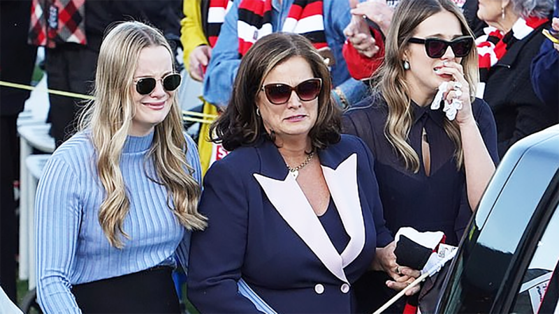 Danny Frawley's wife and daughters, pictured here during his memorial service.