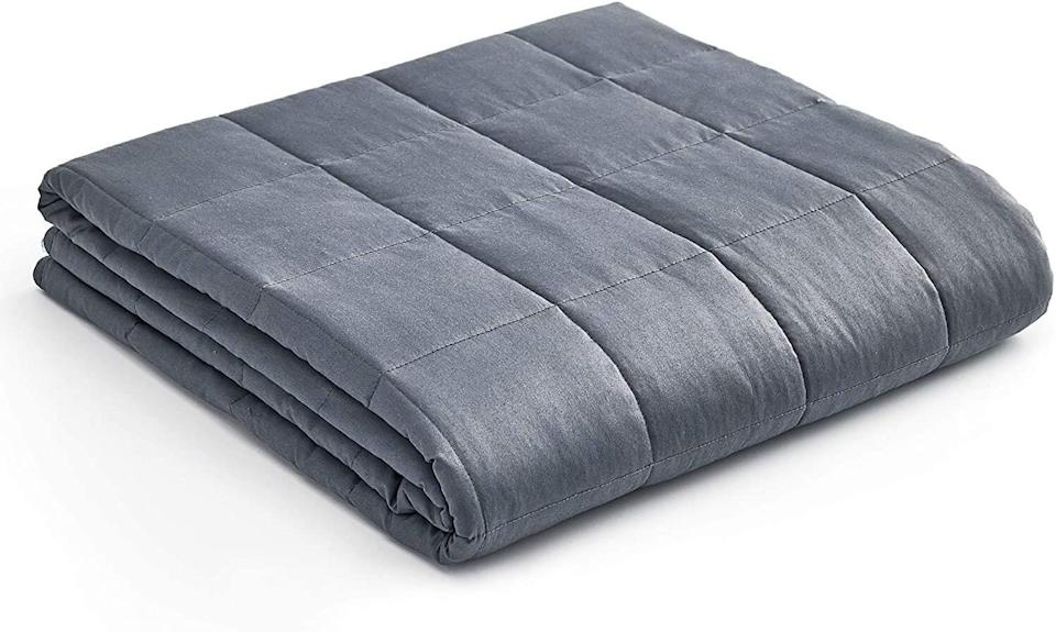 """If your kiddo has a weighted blanket on their wish list, this one is meant for a twin or full-sized bed. This weighted blanket has over 22,000 reviews.<a href=""""https://amzn.to/2H5DV2p"""" target=""""_blank"""" rel=""""noopener noreferrer"""">Originally $80, get it now for $50 at Amazon</a>."""
