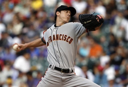 San Francisco Giants starting pitcher Tim Lincecum works against the Colorado Rockies in the first inning of a baseball game in Denver, Saturday, May 18, 2013. (AP Photo/David Zalubowski)