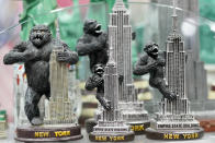 Figurines depicting King Kong on top of the Empire State Building are on display for sale at a gift shop in Lower Manhattan, Tuesday, Nov. 17, 2020. In souvenir shops from Times Square to the World Trade Center, shelves full of T-shirts and trinkets still love New York, as the slogan goes. But the proprietors wonder when their customers will, again. The coronavirus has altered many aspects of life and business in the United States' biggest city, and the pandemic is taking a major toll on the gifts-and-luggage stores that dot tourist-friendly areas. After setting records year after year since 2010, travel to New York has plummeted during the pandemic. (AP Photo/Mary Altaffer)