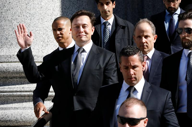 Tesla CEO Elon Musk waves as he leaves Manhattan Federal Court, in New York, Thursday, April 4, 2019. Musk and his lawyers were appearing before a federal judge in New York who will decide whether the Tesla CEO should be held in contempt of court for violating an agreement with the U.S. Securities and Exchange Commission. (AP Photo/Richard Drew)