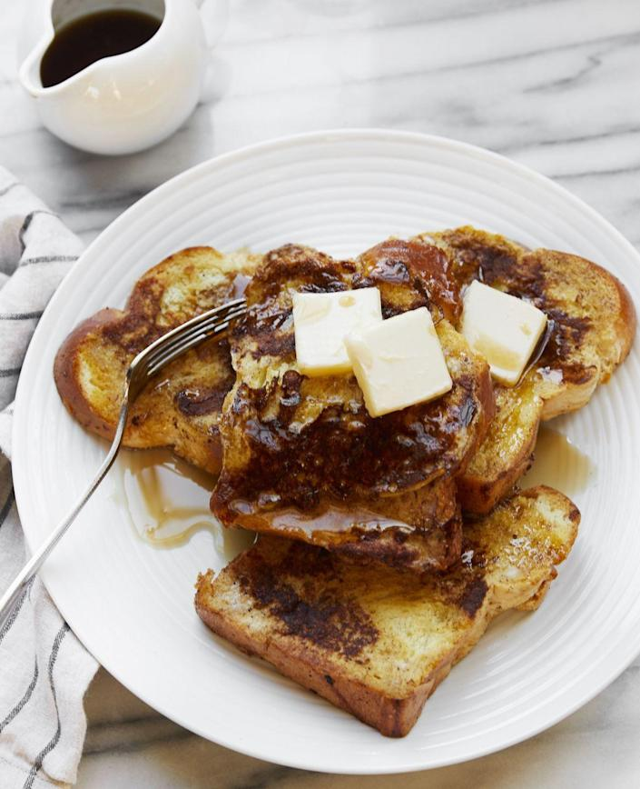 """<p>You can never go wrong with bread and syrup.</p><p>Get the recipe from <a href=""""https://www.delish.com/cooking/recipe-ideas/recipes/a52113/how-to-make-french-toast/"""" rel=""""nofollow noopener"""" target=""""_blank"""" data-ylk=""""slk:Delish"""" class=""""link rapid-noclick-resp"""">Delish</a>.</p>"""