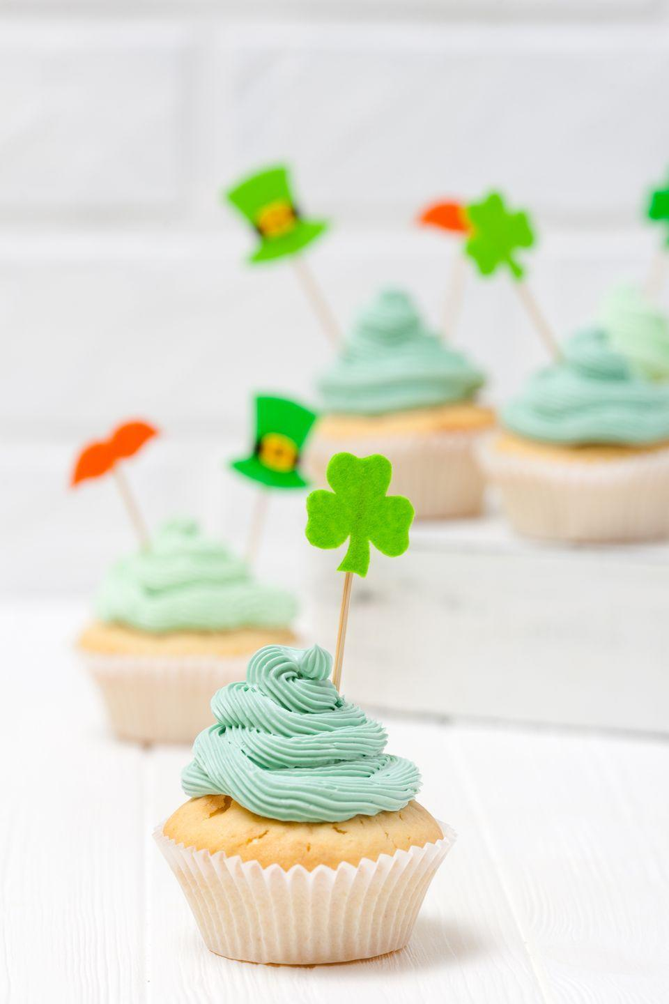 """<p>Whether it's shamrock-shaped cookies, green cupcakes, or <a href=""""https://www.countryliving.com/food-drinks/g2262/st-patricks-day-boozy-desserts/"""" rel=""""nofollow noopener"""" target=""""_blank"""" data-ylk=""""slk:boozy St. Patrick's Day desserts"""" class=""""link rapid-noclick-resp"""">boozy St. Patrick's Day desserts</a>, satisfy your sweet tooth this St. Paddy's Day with a selection of sweet, festive treats.</p><p><a class=""""link rapid-noclick-resp"""" href=""""https://www.amazon.com/Donoter-Cupcake-Shamrock-St-Patricks-Decoration/dp/B07MLWL4JP/?tag=syn-yahoo-20&ascsubtag=%5Bartid%7C10050.g.30796247%5Bsrc%7Cyahoo-us"""" rel=""""nofollow noopener"""" target=""""_blank"""" data-ylk=""""slk:SHOP CUPCAKE TOPPERS"""">SHOP CUPCAKE TOPPERS</a></p>"""