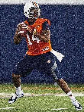 Auburn quarterback Nick Marshall sets to throw during NCAA college football practice Friday, Aug. 1, 2014, in Auburn, Ala. (AP Photo/Brynn Anderson)