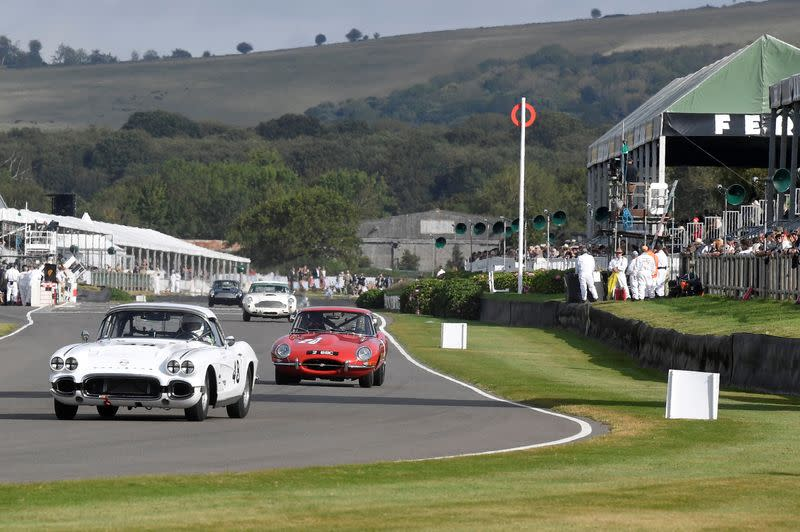 FILE PHOTO: Motoring enthusiasts attend the Goodwood Revival, a three-day historic car racing festival in Goodwood, Chichester