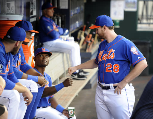 New York Mets second baseman Daniel Murphy (28) greets teammate Dilson Herrara in the dugout before a baseball game against the Philadelphia Phillies at Citi Field on Friday, Aug. 29, 2014, in New York. Herrara was making his major league debut at second base Friday, replacing the injured Murphy. (AP Photo/Kathy Kmonicek)