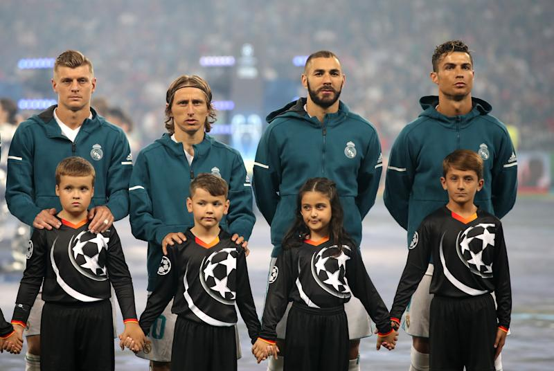 Real Madrid's (left-right) Toni Kroos, Luka Modric, Karim Benzema and Cristiano Ronaldo line up prior to the UEFA Champions League Final at the NSK Olimpiyskiy Stadium, Kiev. (Photo by Nick Potts/PA Images via Getty Images)