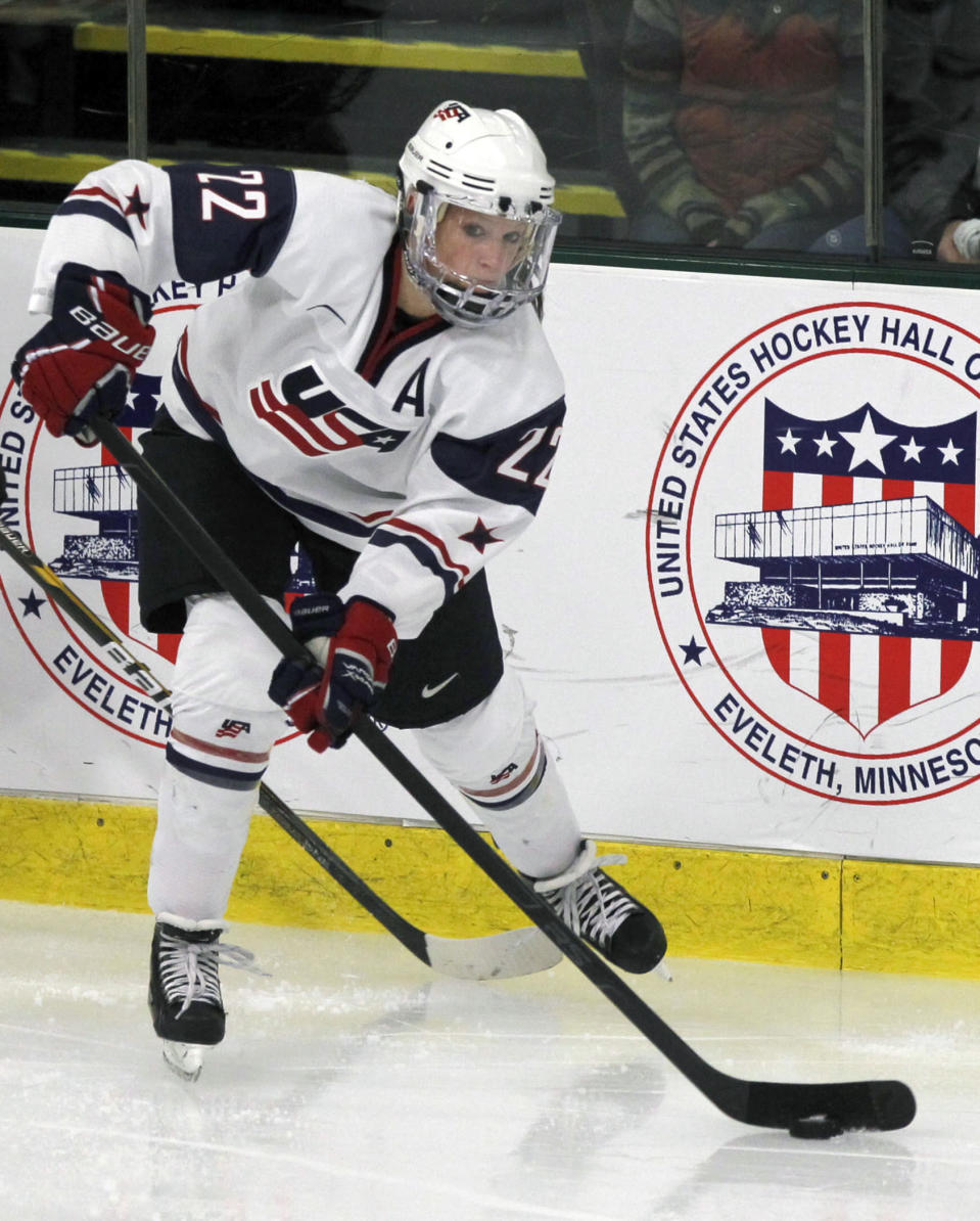 FILE - United States forward Kacey Bellamy (22) plays against Switzerland during the semifinals of the World Women's Ice Hockey Championships in Burlington, Vt., in this Friday, April 13, 2012, file photo. (AP Photo/Toby Talbot, File)