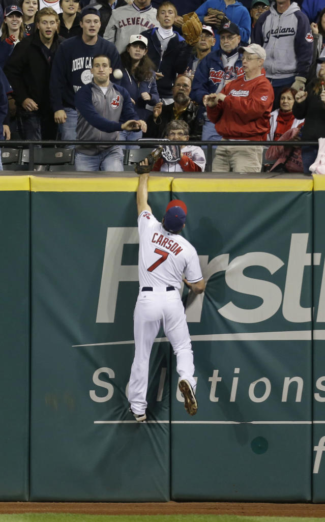 Cleveland Indians' Matt Carson jumps high but cannot catch a home run ball hit by Chicago White Sox's Dayan Viciedo in the ninth inning of a baseball game, Tuesday, Sept. 24, 2013, in Cleveland. (AP Photo/Tony Dejak)