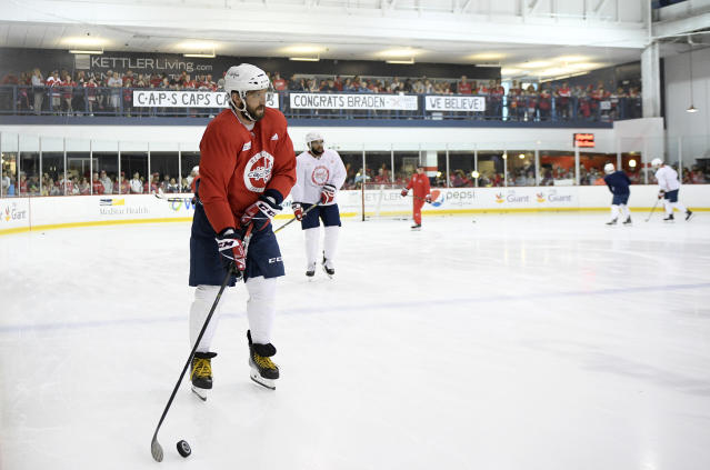 Washington Capitals left wing Alex Ovechkin, left, of Russia, skates with the puck during NHL hockey practice, Saturday, May 26, 2018, in Arlington, Va. Ovechkin is having fun, scoring goals, leading the Capitals to the Stanley Cup Final and destroying the bad rep some laid on him for not being able to get past the second round of the playoffs. (AP Photo/Nick Wass)