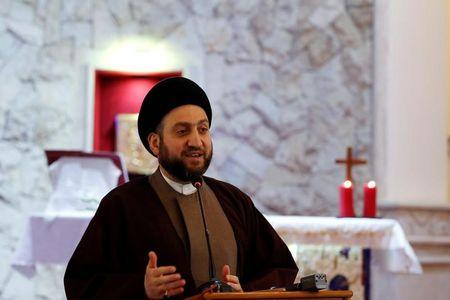 Ammar al-Hakim, leader of the Islamic Supreme Council of Iraq (ISCI), speaks during a mass on Christmas at Mar George Chaldean Church in Baghdad