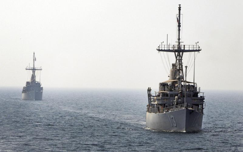 A photo provided by the U.S. Navy, 5th Fleet and dated Aug. 29, 2012, shows USS Navy mine counter measure ships, from right to left, USS Dexrous and USS Sentry get in line to conduct an astern replenishment-at-sea. The United States and more than two dozen allies are gearing up for the largest naval exercises ever in the Middle East focused on countering the threat of anti-ship mines. (AP Photo/U.S. Navy, Toni Burton)