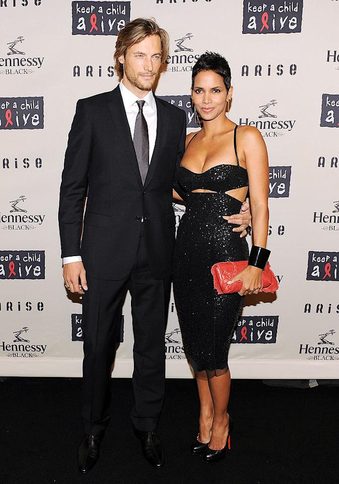 """Is there a more attractive couple out there than Gabriel Aubry and Halle Berry? The duo looked simply stunning upon arriving at the 6th Annual Keep a Child Alive Black Ball, held at the Hammerstein Ballroom in NYC. Stephen Lovekin/<a href=""""http://www.gettyimages.com/"""" target=""""new"""">GettyImages.com</a> - October 15, 2009"""