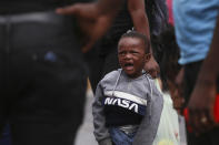 A Haitian migrant child cries at the Padre Infante shelter, in Monterrey, Mexico, Wednesday, Sept. 22, 2021. (AP Photo/Roberto Martinez)