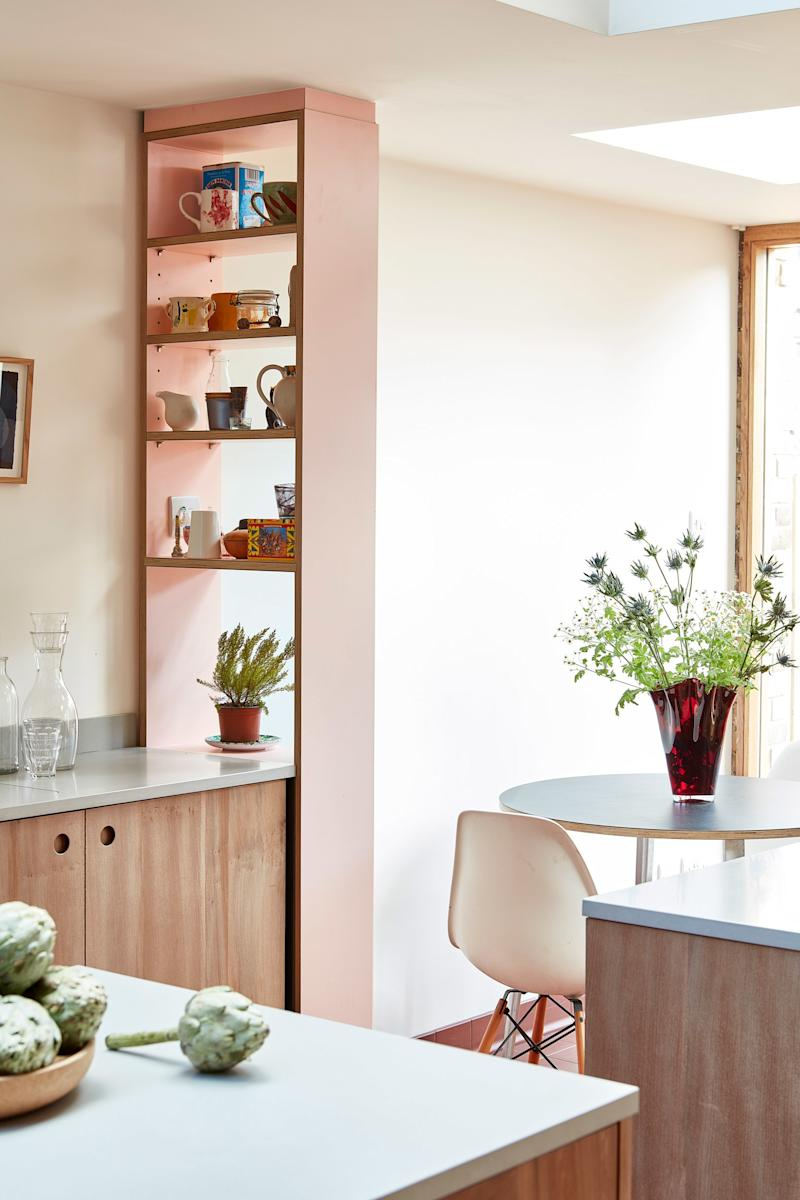 After: A charming blush-pink shelving unit by Pluck—the specific color is 'Ruskin Blossom'—differentiates the breakfast nook from the kitchen without blocking any natural light from entering the space.