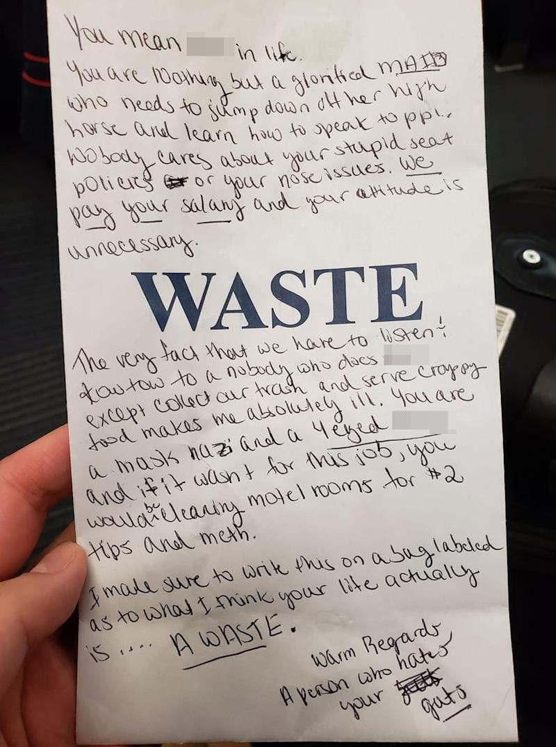 A disgruntled passenger's note to an airline steward is pictured after they were asked to wear a face mask.