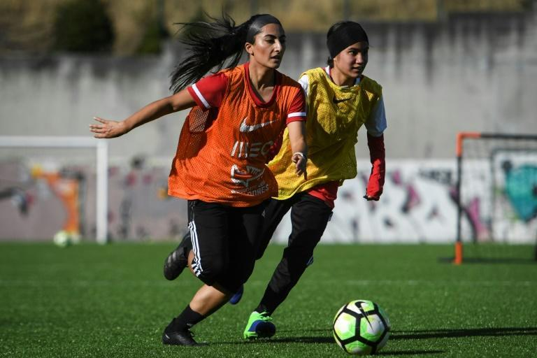 Players of Afghanistan national women's youth football team attend a training session on the outskirts of Lisbon where they have found safe haven after escaping from the Taliban (AFP/PATRICIA DE MELO MOREIRA)