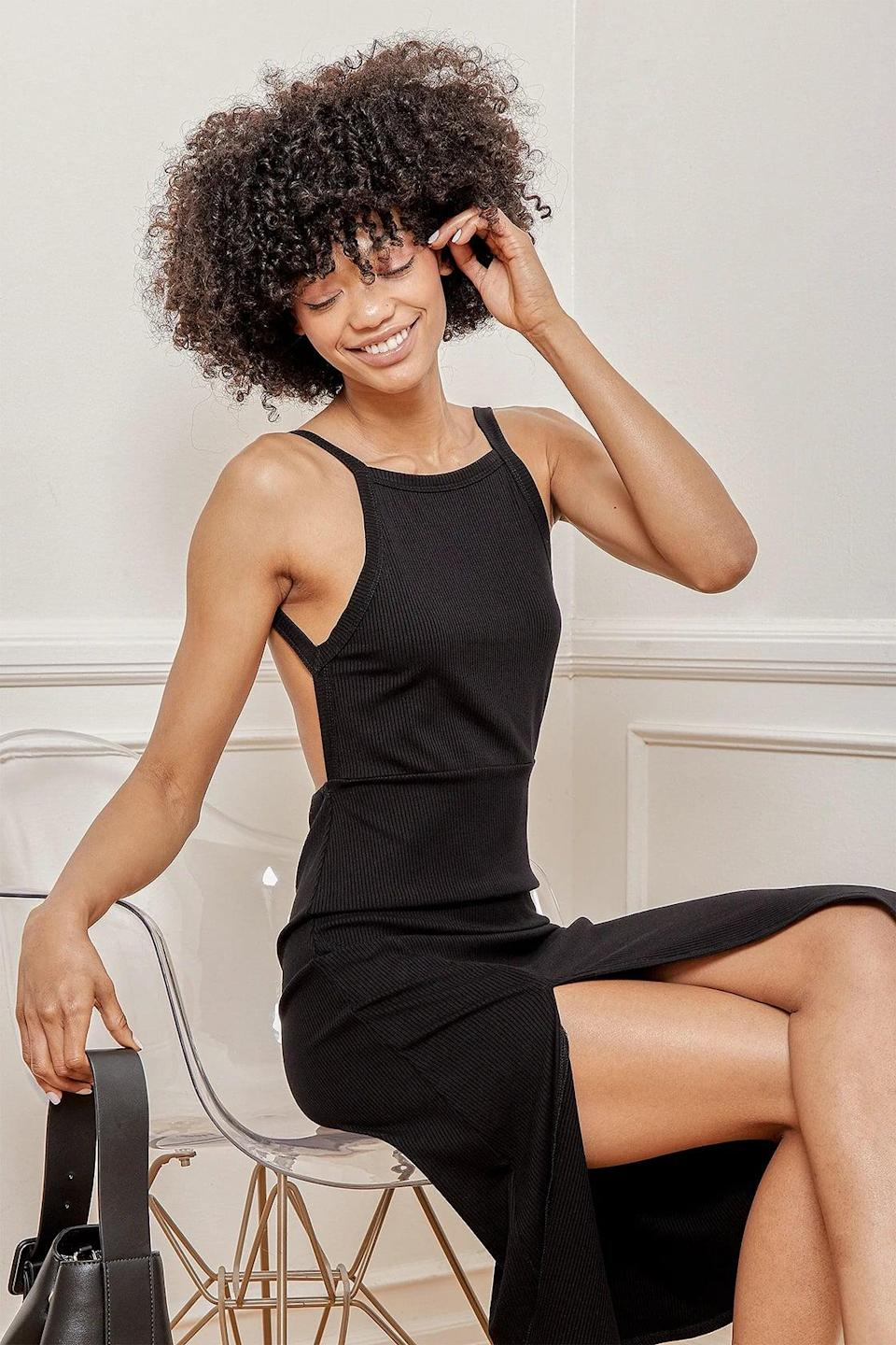 <p>I'm sold on the back (or lack thereof) of this <span>It's Serendipity Black Ribbed Backless Midi Dress</span> ($54).</p>