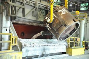 Recycled molten metal, after being siphoned from a melting furnace at Arconic's Tennessee operations, is added to a holding furnace to make cast weight according to customer specifications.