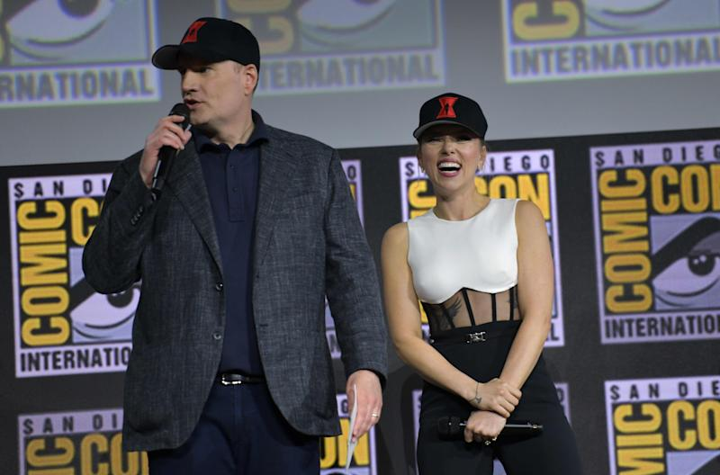 President of Marvel Studios Kevin Feige (L) and US actress Scarlett Johansson speak on stage for the Marvel panel in Hall H of the Convention Center during Comic Con in San Diego, California on July 20, 2019. (Photo by Chris Delmas / AFP)CHRIS DELMAS/AFP/Getty Images ORIG FILE ID: AFP_1IZ0OC
