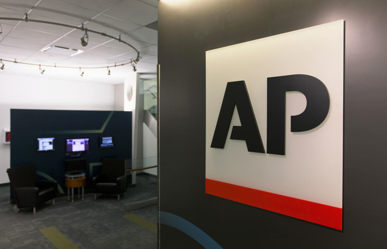 FILE - This Tuesday, April 26, 2016 file photo shows The Associated Press logo in New York. The Associated Press is teaming with the Howard Hughes Medical Institute's Department of Science Education to expand its coverage of science, medicine and health journalism. (AP Photo/Hiro Komae)