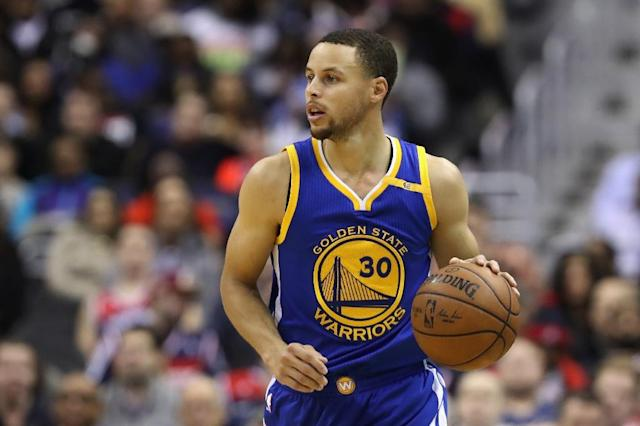 Stephen Curry of the Golden State Warriors topped a list of the best-selling jerseys from the 2016-2017 season (AFP Photo/Rob Carr)