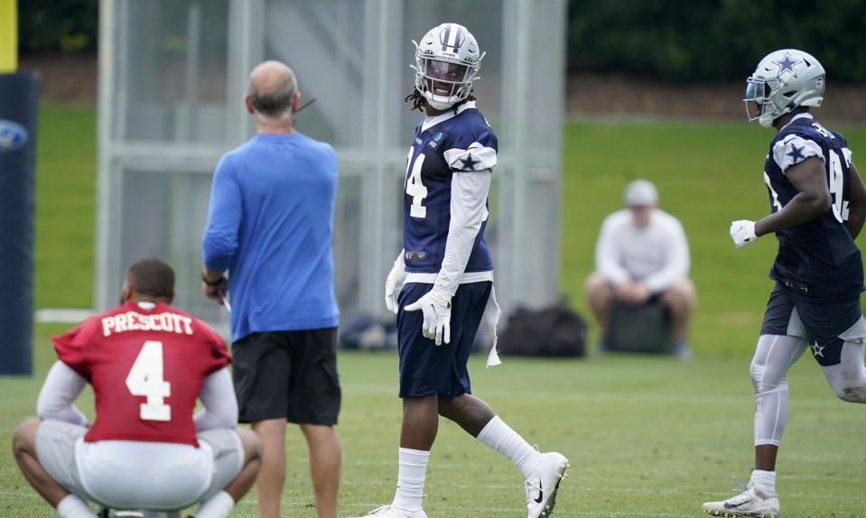 Dallas Cowboys defensive end Randy Gregory (94) walks the field during an NFL football team practice Wednesday, June 9, 2021, in Frisco, Texas. Gregory isn't ashamed of a suspension-filled past that nearly derailed his NFL career, just maybe a little tired of it being the focus of his story. (AP Photo/LM Otero)