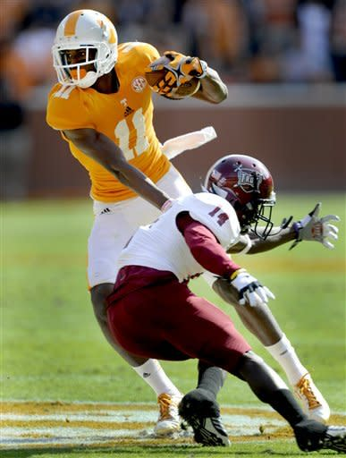 Tennessee wide receiver Justin Hunter (11) dodges Troy defensive back Zach Miller (14) during the first half of their NCAA college football game, Saturday, Nov. 3, 2012, in Knoxville, Tenn. (AP Photo/Knoxville News Sentinel, Michael Patrick)