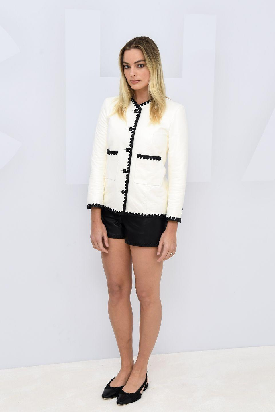 <p><strong>6 October</strong> Margot Robbie also attended the Chanel show virtually, wearing a white jacket and black shorts by the French fashion house.</p>