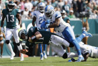Philadelphia Eagles' Carson Wentz, left, is tackled by Detroit Lions' Quandre Diggs during the first half of an NFL football game, Sunday, Sept. 22, 2019, in Philadelphia. (AP Photo/Michael Perez)
