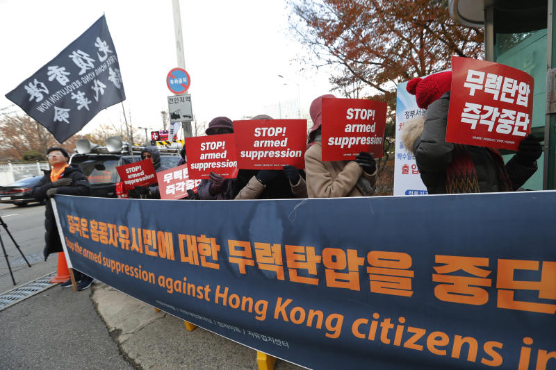 Protesters stage a rally to oppose a visit by Chinese Foreign Minister Wang Yi in front of the Foreign Ministry in Seoul, South Korea, Wednesday, Dec. 4, 2019. Wang arrived in South Korea on Wednesday for his first visit in four years amid bilateral efforts to patch up relations damaged by Seoul's decision to host a U.S. anti-missile system Beijing perceives as a security threat. (AP Photo/Ahn Young-joon)