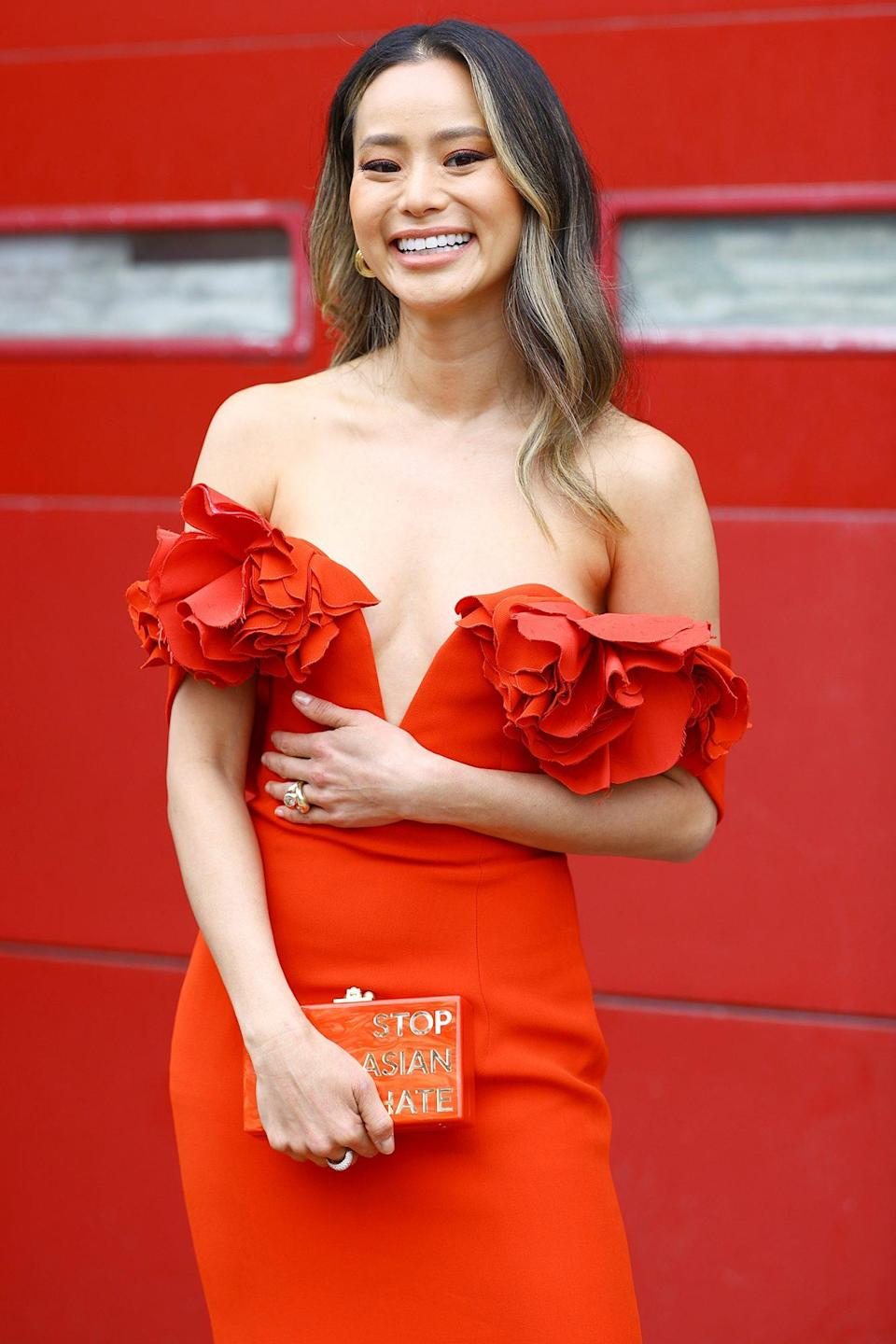 "<p>Jamie Chung is beaming in her strapless red gown and ""Stop Asian Hate"" clutch ahead of the 27th Annual Screen Actors Guild Awards in N.Y.C.</p>"