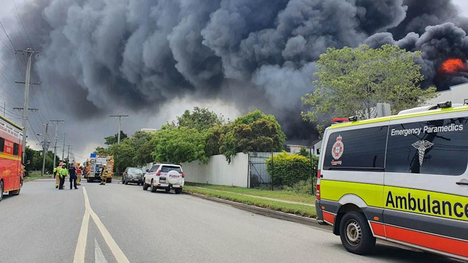 Emergency crews are on scene at a building fire in Hemmant, Queensland. Source: Twitter/Queensland Ambulance