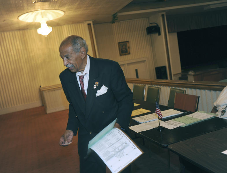FILE - In a Tuesday, Aug. 5, 2014 file photo, Congressman John Conyers votes at Word of Power Ministry in Highland Park, Mich.  Detroit police say the former congressman died at his home on Sunday, Oct. 27, 2019. He was 90. (Brandy Baker/Detroit News via AP)