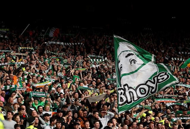 Soccer Football - Scottish Cup Semi Final - Celtic vs Rangers - Hampden Park, Glasgow, Britain - April 15, 2018 Celtic fans raise scarves during the match Action Images via Reuters/Lee Smith