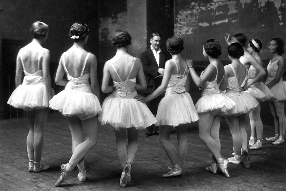 """Members of the Paris Opera Ballet—the world's oldest <a href=""""https://www.cntraveler.com/stories/2015-01-31/david-hallberg-meet-the-ambassador-of-the-new-age-of-ballet?mbid=synd_yahoo_rss"""" rel=""""nofollow noopener"""" target=""""_blank"""" data-ylk=""""slk:national ballet company"""" class=""""link rapid-noclick-resp"""">national ballet company</a>—listening to the ballet master during a rehearsal of """"Swan Lake."""""""