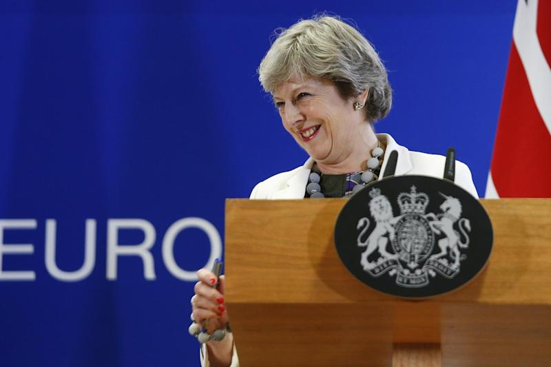 The Prime Minister is under pressure from Tory MPs who favour a harder Brexit: EPA